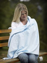 SwaddleDesigns multi-use swaddling blanket can be used as a privacy throw, sun shield or play mat!