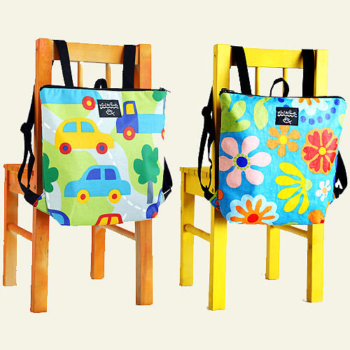 Adjustable straps, a sturdy zipper, durable, safe fabric, and a loop for hanging