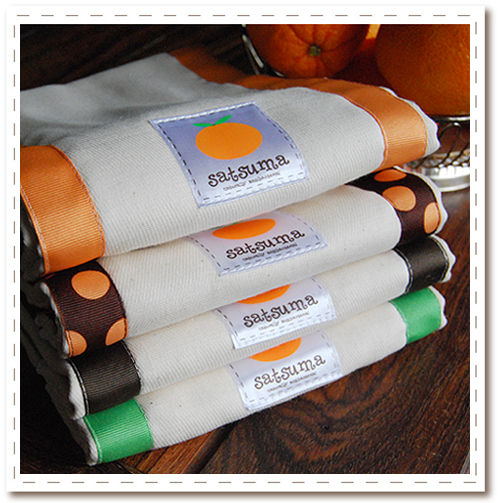 Our 100% unbleached cotton burp cloths with gros grain ribbon details - nursery essential with some flair!