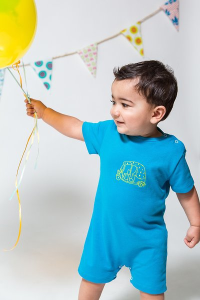 Lil Trunks' Jacob romper vibrates with saturated hues, matching the energy and fun of childhood.