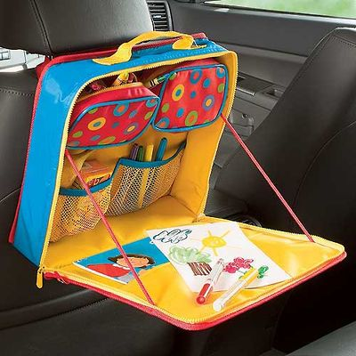 A fold-out desk that attaches the headrest of the front seat