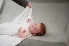 The Zen Swaddle by Nested Bean offers value by providing room for baby to grow and the ability to swaddle with arms in or out.
