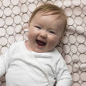 SwaddleDesigns now offers fitted crib sheets.
